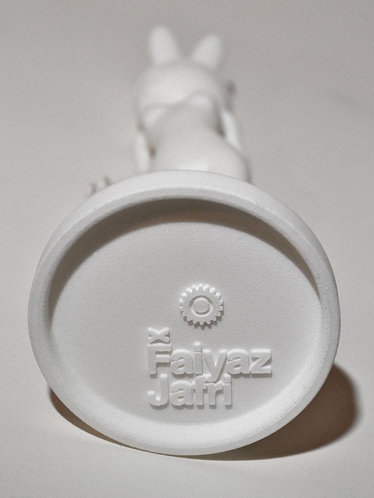 Faiyaz Jafri logo at bottom of sculpture